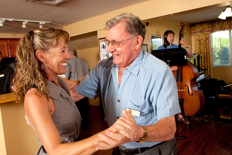 Resident and staff member dancing