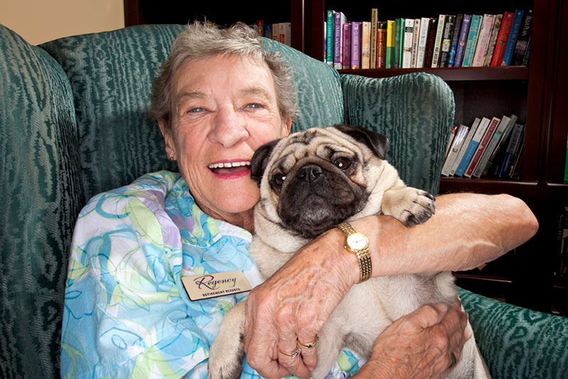 Resident holding dog photo